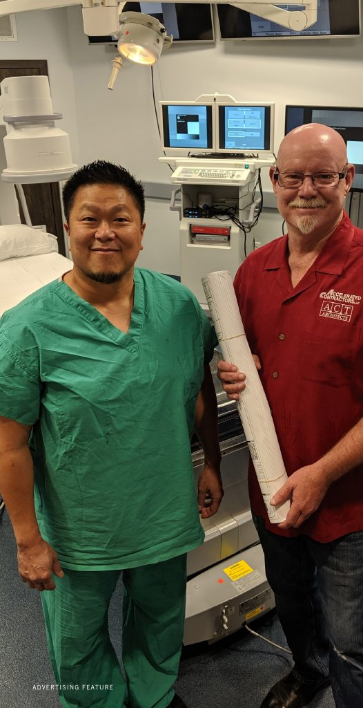 Dr. Chong shown with Brad Hollett in Medical facility built by Brad and his team of medical construction experts